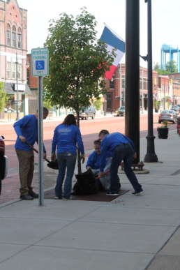 The Homestead team replacing mulch for a tree in downtown Albion.