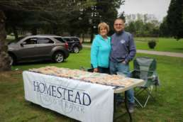 Homestead Saving Bank handing out cookies at the Swinging at the Shell event.
