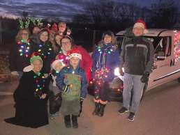 The Homestead team decorated in lights and holiday hats to celebrate the Albion Aglow Parade.