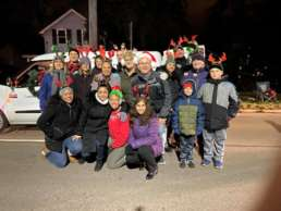 The Homestead Savings Bank team huddled together in their winter coats for the Annual Marshall Christmas Parade.