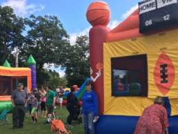 The community enjoying the bounce castles at the Leslie Fall Festival event.